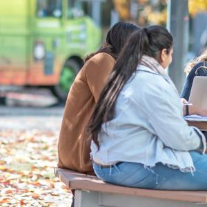 Photo of students collaborating on campus
