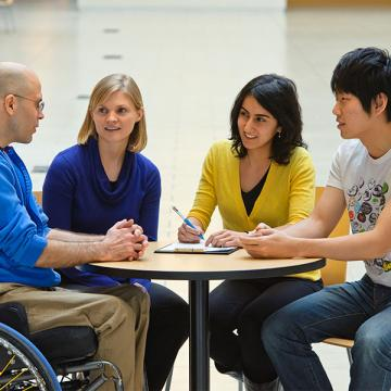 Photo of students having a conversation with their health mentor